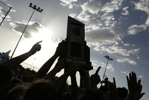Keith Johnson | The Salt Lake Tribune  Salem Hills' players and fans hold the 4A softball championship trophy after beating Box Elder May 23, 2013.