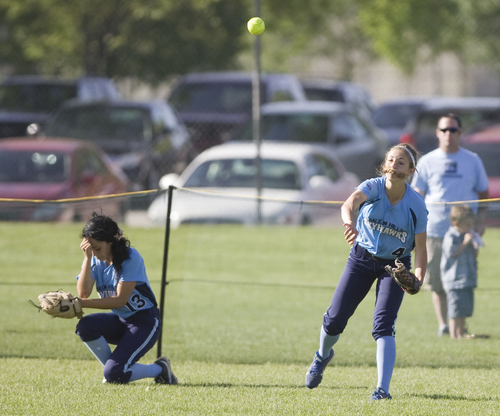 Keith Johnson | The Salt Lake Tribune  Salem Hills' outfielder Tiffany Madson throws the ball to 2nd base after left fielder Alexis Oveson  dropped a long fly ball during the 4A softball championship game May 23, 2013. Salem Hills beat Box Elder for the title.
