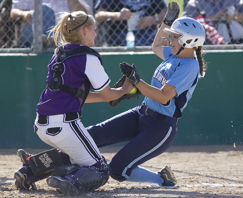 Keith Johnson | The Salt Lake Tribune  Box Elder catcher Molly Horne tags Salem Hills' Kenzie Martin out at home during their 4A softball championship game May 23, 2013. Salem Hills went on to claim the title.