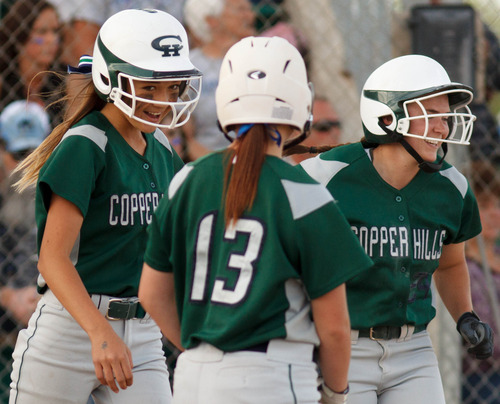 Trent Nelson  |  The Salt Lake Tribune Copper Hills' Mikelle Magalogo, Kiera Siddoway and Emilee Sweet celebrate a pair of runs as Copper Hills defeats Bingham High School in the 5A softball tournament in Taylorsville Wednesday May 22, 2013. Alta Academy.