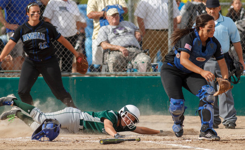Trent Nelson  |  The Salt Lake Tribune Copper Hills' Emilee Sweet scores as Copper Hills defeats Bingham High School in the 5A softball tournament in Taylorsville Wednesday May 22, 2013. Alta Academy.