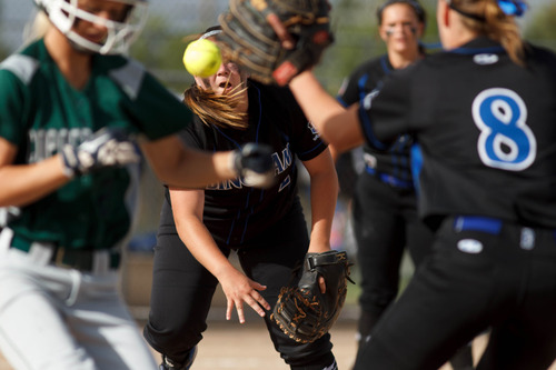 Trent Nelson  |  The Salt Lake Tribune Bingham's Taylor Clemens throws to first as Copper Hills defeats Bingham High School in the 5A softball tournament in Taylorsville Wednesday May 22, 2013. Alta Academy.