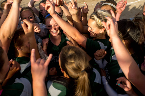 Trent Nelson  |  The Salt Lake Tribune Copper Hills players celebrate after defeating Bingham High School in the 5A softball tournament in Taylorsville Wednesday May 22, 2013. Alta Academy.