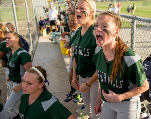 Trent Nelson  |  The Salt Lake Tribune Copper Hills' Cassidy Bentley and Suzi Sullivan cheer on their teammates during a game against Bingham High School in the 5A softball tournament in Taylorsville Wednesday May 22, 2013. Alta Academy.