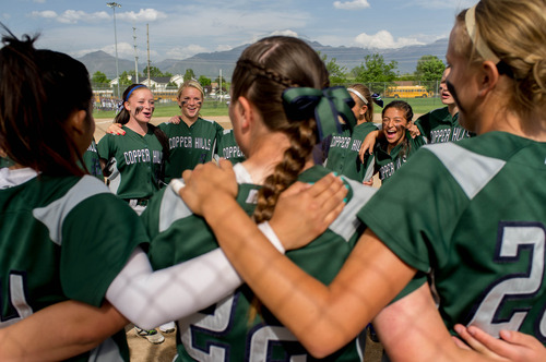 Trent Nelson  |  The Salt Lake Tribune Copper Hills players huddle before defeating Bingham High School in the 5A softball tournament in Taylorsville Wednesday May 22, 2013. Alta Academy.