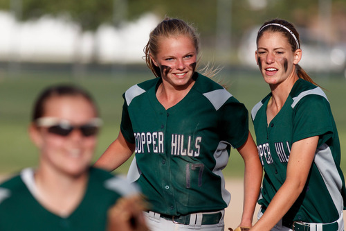 Trent Nelson  |  The Salt Lake Tribune Copper Hills' Ashley Anderson and Paige Watts celebrate an out as Copper Hills defeats Bingham High School in the 5A softball tournament in Taylorsville Wednesday May 22, 2013. Alta Academy.