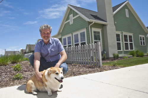 Chris Detrick  |  The Salt Lake Tribune Doug Monroe poses for a portrait with his dog Duncan at their home in Daybreak in South Jordan Wednesday May 22, 2013.