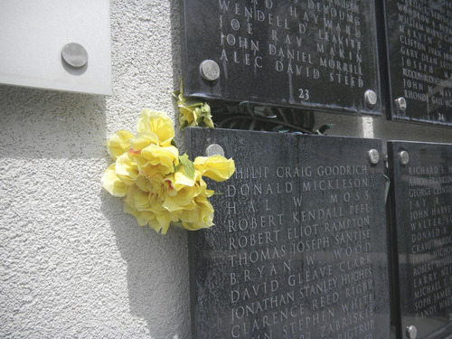 Tom Wharton  |  The Salt Lake Tribune Yellow rose at the Farmington cemetery veteran's memorial honor a fallen soldier.
