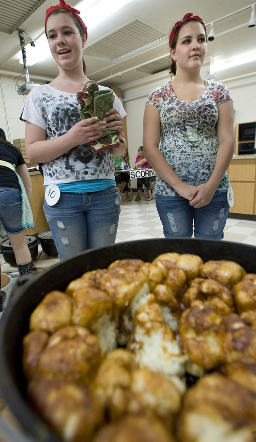 Paul Fraughton  |  The Salt Lake Tribune Taylor Elmer and Aubree Adams stand in front of their sticky buns  that were a hit with the judges at Riverview Jr. High School's ninth-grade Dutch oven cook-off.                           Friday, May 10, 2013