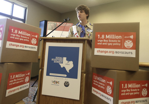 Boys Scout Alex Derr speaks out against anit-gay rules during the Equal Scouting Summit Press Conference being held near where the Boy Scouts of America are holding their annual meeting Wednesday, May 22, 2013, in Grapevine, Texas. The boxes in front of Derr hold petitions calling for the Boy Scouts of America to end its anti-gay policies. (AP Photo/LM Otero)