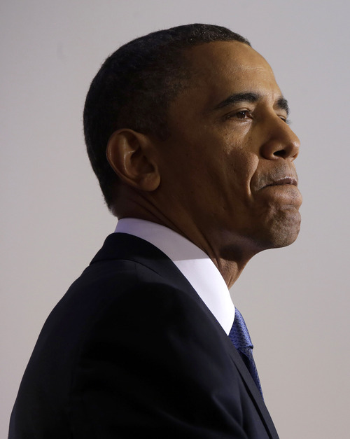 """President Barack Obama pauses while talking about national security, Thursday, May 23, 2013, at the National Defense University at Fort McNair in Washington. Declaring America at a """"crossroads"""" in the fight against terrorism, the president revealed clearer guidelines for the use of deadly drone strikes, including more control by the U.S. military, while leaving key details of the controversial program secret. (AP Photo/Pablo Martinez Monsivais)"""