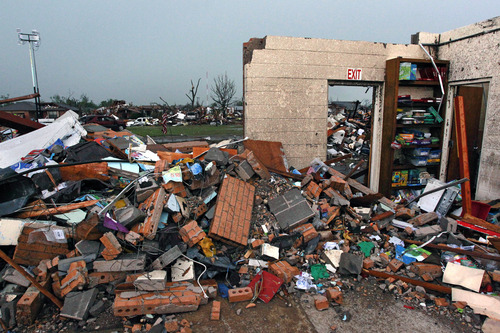 Part of a wall stands amid the wreckage of Plaza Towers Elementary School, where seven children were killed earlier in the week when a tornado hit Moore, Okla., Thursday, May 23, 2013. The huge tornado roared through the Oklahoma City suburb Monday, flattening entire neighborhoods and destroying the elementary school with a direct blow as children and teachers huddled against winds up to 200 mph. (AP Photo/Brennan Linsley)