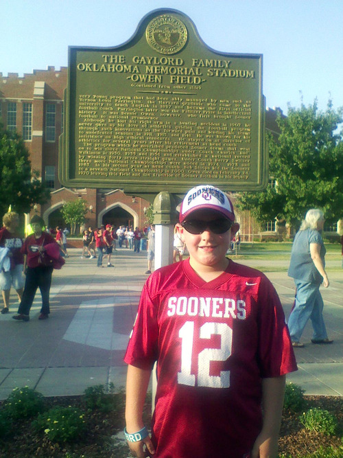 """In this Nov. 2012 photo provided by the his family, 8-year-oldtornado victim Kyle Davis poses for a photo while attending an Oklahoma University football game at Owen Field, in Norman, Okla. Nicknamed """"The Wall,"""" Davis loved soccer and going to the Monster Truck exhibitions at thefairgrounds with his grandfather. Kyle was killed Monday, May 20, 2013, when a huge tornado roared through Moore, Okla., flattening entire neighborhoods and destroying Kyle's elementary school with a direct blow as children and teachers huddled against winds up to 200 mph. (AP Photo/The Kyle Davis Family)"""