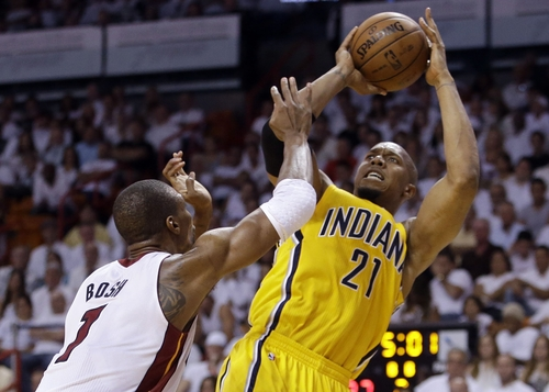 Indiana Pacers forward David West (21) attempts a basket over Miami Heat defender Chris Bosh (1) during the first half of Game 2 in their NBA basketball Eastern Conference finals playoff series, Friday, May 24, 2013, in Miami. (AP Photo/Lynne Sladky)