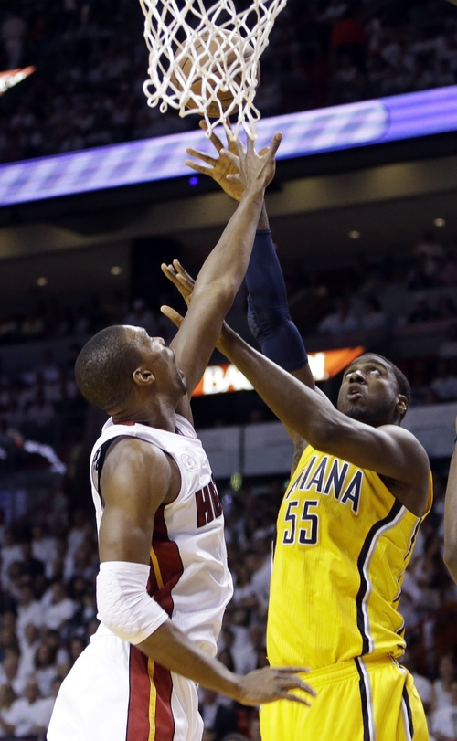 Indiana Pacers center Roy Hibbert (55) shoot the ball as Miami Heat center Chris Bosh defends during the first half of Game 2 in their NBA basketball Eastern Conference finals playoff series, Friday, May 24, 2013, in Miami. (AP Photo/Lynne Sladky)