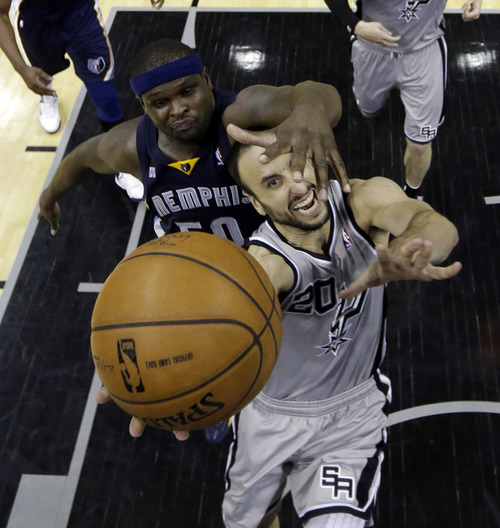 San Antonio Spurs' Manu Ginobili (20), of Argentina, is defended by Memphis Grizzlies' Zach Randolph, left, as he drives to the basket during the second half in Game 2 of a Western Conference Finals NBA basketball playoff series, Tuesday, May 21, 2013, in San Antonio. (AP Photo/Ronald Martinez, Pool)