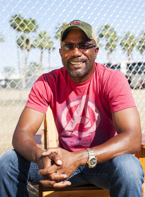 """FILE - In this April 28, 2013 file photo, singer Darius Rucker poses for a portrait backstage on day 3 of the 2013 Stagecoach Music Festival at the Empire Polo Club, in Indio, Calif. Rucker's version of """"Wagon Wheel"""" is the most successful song of his country career. The cut from his third Nashville-recorded album, """"True Believers,"""" out on May 21, 2013, has sold nearly 1.2 million copies and sat atop the country charts for three consecutive weeks early this year. (Photo by Dan Steinberg/Invision/AP, File)"""