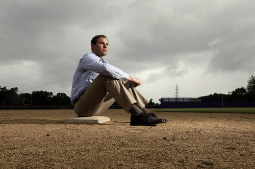 In this Thursday, May 23, 2013 photo, Garrett Broshuis poses for a photo at a baseball field in St. Louis. Broshuis, a former minor leaguer for the San Francisco Giants, has talked about the cheating he observed during his time playing professionally, even going so far as to say one of his coaches suggested he try it. (AP Photo/Jeff Roberson)