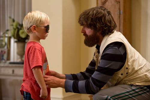 "Grant Holmquist as Tyler/Carlos, left, and Zach Galifianakis as Alan appear in a scene from ""The Hangover Part III"" from Warner Bros. Pictures."