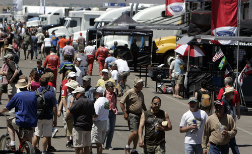 Fans make their way through the paddock before the Utah Grand Prix American Le Mans race Sunday, May 17, 2009 at Miller Motorsports Park in Tooele, Utah. De Ferran Motorsports won the Grand Prix by a margin of approximately of 70 seconds. Jim Urquhart/The Salt Lake Tribune