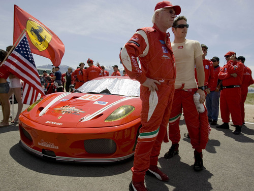Steve Pruitt, center, and driver Gunnar Jeannette, both of Salt Lake City-based Corsa Motorsports talk next to their Ferrari 430 GT prior to running of the American Le Mans Series' Utah Grand Prix Sunday, May 18, 2008 at the Miller Motorsports Park. The racers ran their cars all out on the 3.048 miles course for two hours and 45 minutes at the Tooele facility. 5/18/2008 Jim Urquhart/The Salt Lake Tribune