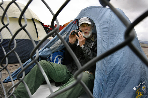 Scott Sommerdorf  |  The Salt Lake Tribune              Tom Taggart of Durango, Colorado who says he has not missed a Superbike race yet at Miller Motorsports Park, watches FIM Superbike World Championship free practice from his usual spot in a tent above The Attitudes turns, Sunday, May 27, 2012.