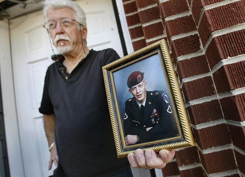 Scott Sommerdorf     The Salt Lake Tribune              Michael Stewart, father of Matthew Davis Stewart, 37, holds a photo of his son outside his Ogden home, Thursday, January 5, 2012.