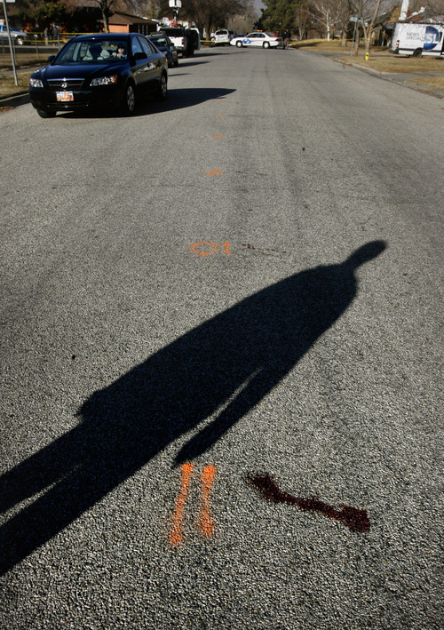 """Scott Sommerdorf     The Salt Lake Tribune              Near the spray-painted number """"11"""" is a blood stain where police took Matthew Davis Stewart after the shooting on Jackson St. in Ogden, Thursday, January 5, 2012. Five police officers were injured and one killed in a firefight during a drug raid Wednesday night."""