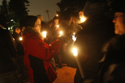 """Chris Detrick     The Salt Lake Tribune Family and friends of Matthew Stewart participate in """"a candlelight time of silence for peace,"""" across from Stewart's home in Ogden on Friday."""