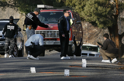 Scott Sommerdorf  |  The Salt Lake Tribune              Police investigators look at the area on Jackson Street outside the home at 3268 Jackson St. in Ogden, Thursday, January 5, 2012. There were numerous evidence markers on the street marking the spot of bullet casings or other evidence. Five police officers were injured and one killed in a firefight during a drug raid Wednesday night.