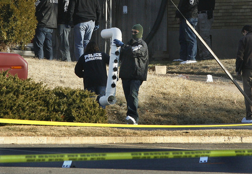 Scott Sommerdorf     The Salt Lake Tribune              Police bring out various pieces of evidence from the home at 3268 Jackson St. in Ogden, Thursday, January 5, 2012. Five police officers were injured and one killed in a firefight during a drug raid Wednesday night.