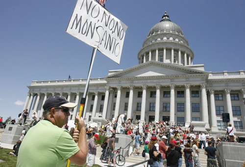 Scott Sommerdorf  |  The Salt Lake Tribune Kenny Phillips was one of hundreds of protesters taking part in the March Against Monsanto Saturday at the Utah State Capitol. The crowd was demonstrating against genetically modified foods produced by seeds from Monsanto.
