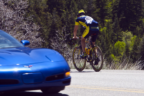 Chris Detrick  |  The Salt Lake Tribune A cyclist bikes in Little Cottonwood Canyon Saturday May 25, 2013.