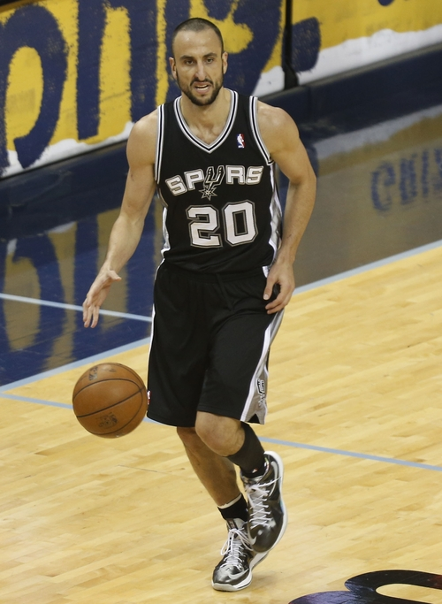 San Antonio Spurs shooting guard Manu Ginobili (20) dribbles the ball during the second half in Game 3 of the Western Conference finals NBA basketball playoff series against the Memphis Grizzlies, Saturday, May 25, 2013, in Memphis, Tenn. (AP Photo/Rogelio V. Solis)