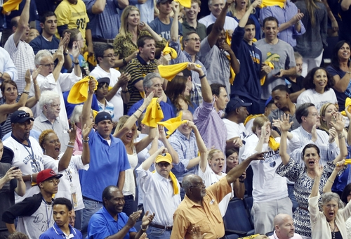 Memphis Grizzlies cheer the team during the first half of Game 3 in their NBA basketball Western Conference finals playoff series against the San Antonio Spurs , Saturday, May 25, 2013 in Memphis, Tenn. (AP Photo/Rogelio V. Solis)