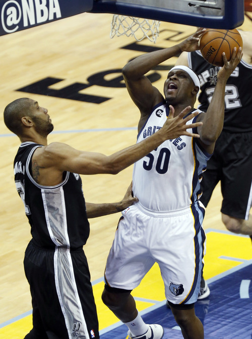 Memphis Grizzlies forward Zach Randolph (50) attempts to score as San Antonio Spurs forward Tim Duncan (21) defends during the first half of Game 3 in their NBA basketball Western Conference finals playoff series, Saturday, May 25, 2013, in Memphis, Tenn. (AP Photo/Rogelio Solis)