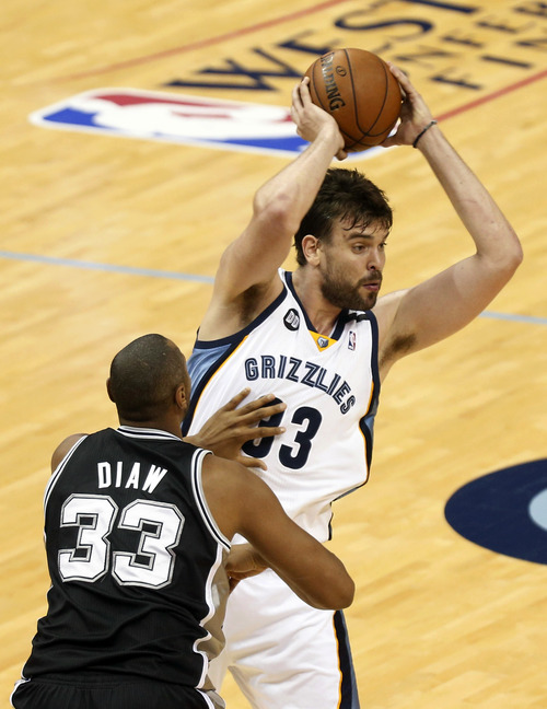 Memphis Grizzlies center Marc Gasol (33), of Spain, looks to pass around San Antonio Spurs defender Boris Diaw (33) during the first half in Game 3 of the Western Conference finals NBA basketball playoff series, Saturday, May 25, 2013, in Memphis, Tenn. (AP Photo/Rogelio V. Solis)
