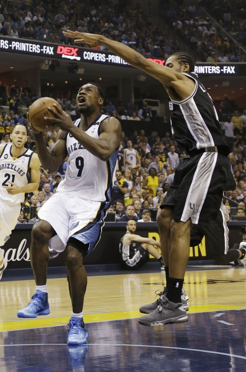 Memphis Grizzlies  guard Tony Allen (9) drives to the basket as San Antonio Spurs forward Kawhi Leonard (2) defends during the first half  of Game 3 of the Western Conference finals NBA basketball playoff series in Memphis, Tenn., Saturday, May 25, 2013. (AP Photo/Danny Johnston)