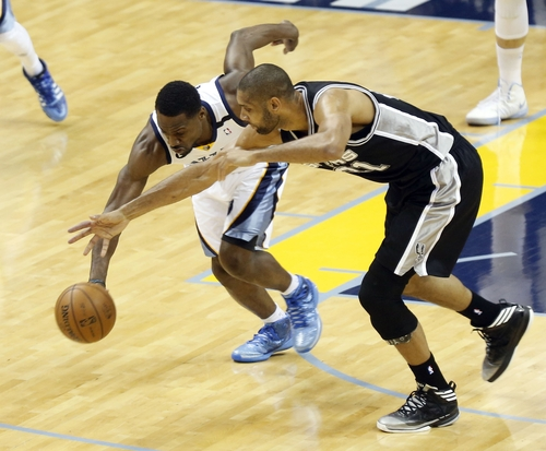 Memphis Grizzlies guard Tony Allen (9) steals the ball as San Antonio Spurs forward Tim Duncan (21) tries to recover during the first half of Game 3 in their NBA basketball Western Conference finals playoff series, Saturday, May 25, 2013, in Memphis, Tenn. (AP Photo/Rogelio Solis)