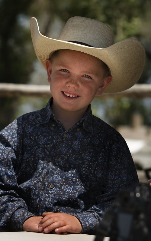 Leah Hogsten  |  The Salt Lake Tribune Toby Wren, 6, of Alton, Utah at the 8th Annual Cowboy Legends Cowboy Poetry and Music Festival, Saturday, May 25, 2013, celebrating the cowboy ranching history at the Fielding Garr Ranch on Antelope Island.