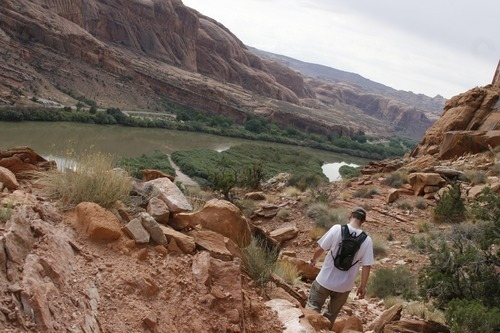 Normand Garcia | The Salt Lake Tribune Tribune reporter Nate Carlisle walks down the Portal Overlook Trail near Moab on Oct. 2, 2011. The trail parallels and offers views of the Colorado River.