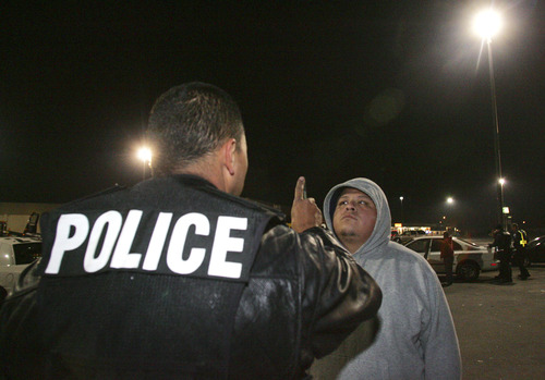 Officer Rudy Anaya gives a field sobriety check to Adam Lopez during a DUI crackdown in Fresno, Calif., in a Saturday, Dec. 2, 2006 photo. Police in Fresno are throwing up roadblocks, conducting stakeouts and using night-vision goggles, satellite tracking devices and video cameras in an extraordinary crackdown aimed not at terrorists or drug lords, but at drunken drivers. (AP Photo/Gary Kazanjian)
