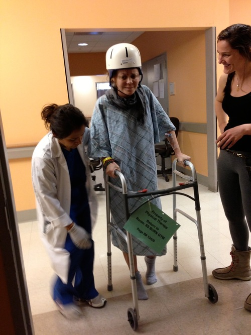 Courtesy of Sheila Haas Nikki Breedlove takes her first post-accident steps on Feb. 28, at Weill Cornell Medical Center in New York City. To her right is lifelong friend Cody Carter, of Las Vegas, who took off work for a week to stay with Breedlove in New York City.