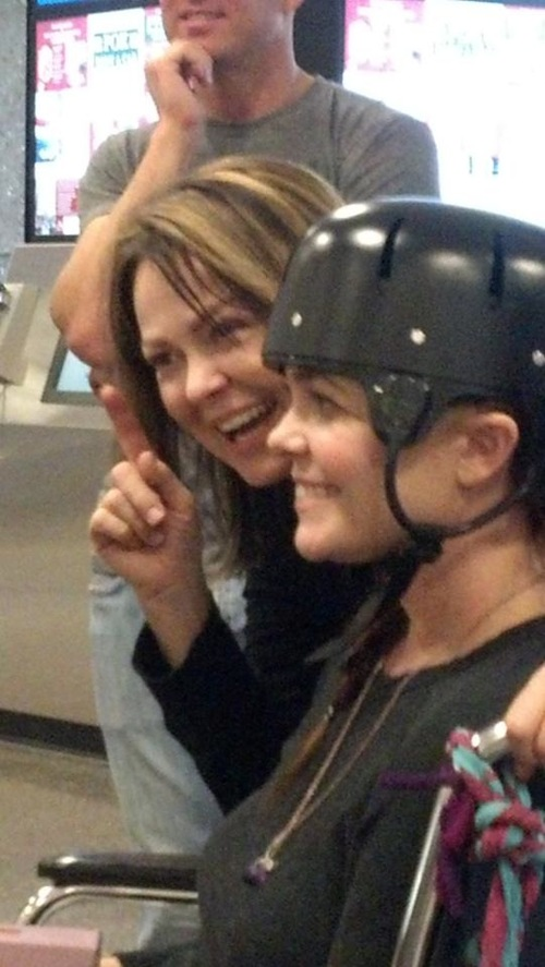 Courtesy of Sheila Haas On March 14, Nikki Breedlove (in her helmet) and her mom, Sheila Haas, meet with Breedlove's friends during a layover at Salt Lake City's airport.