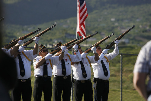 Scott Sommerdorf      The Salt Lake Tribune An honor guard gives a 21-gun salute at the Memorial Day ceremony at the Salem City Cemetery, Monday May 27, 2013. Salem is the hometown of Utah soldier Spc. Cody Towse, who died last week in Afghanistan.