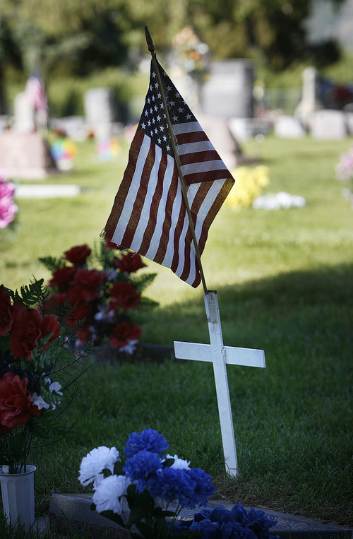 Scott Sommerdorf      The Salt Lake Tribune One of many graves decorated for the Memorial Day ceremony at the Salem City Cemetery, Monday May 27, 2013. Salem is the hometown of Utah soldier Spc. Cody Towse, who died last week in Afghanistan.