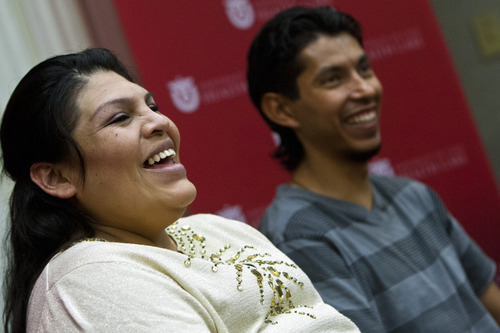 Chris Detrick  |  The Salt Lake Tribune Guillermina and Fernando Garcia laugh during a press conference at the University of Utah Hospital Tuesday May 28, 2013. The couple welcomed quintuplets to the world on Sunday. Their names, in the order of their birth, are: Esmeralda, Fatima, Fernando, Marissa, Jordan.