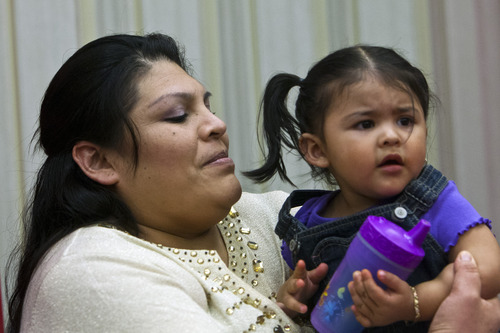 Chris Detrick  |  The Salt Lake Tribune Guillermina Garcia and her 18-month-old daughter Julietta listen during a press conference at the University of Utah Hospital Tuesday May 28, 2013. Garcia, 34, of Salt Lake City, delivered quintuplets Sunday morning at the hospital.