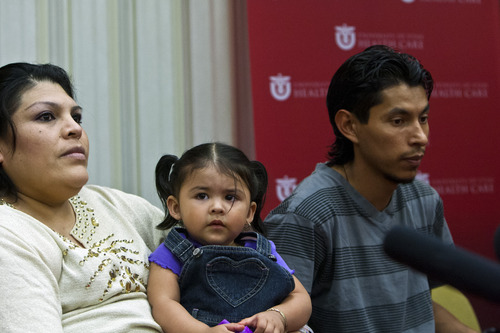 Chris Detrick  |  The Salt Lake Tribune Guillermina and Fernando Garcia and their 18-month-old daughter Julietta, listen during a press conference at the University of Utah Hospital Tuesday May 28, 2013. Guillermina Garcia, 34, of Salt Lake City, delivered quintuplets Sunday morning at the hospital. Their names, in the order of their birth, are: Esmeralda, Fatima, Fernando, Marissa, Jordan.
