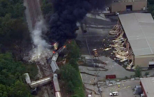 This image provided by WBAL-TV, shows a train derailment outside Baltimore on Tuesday, May, 28, 2013. A fire spokeswoman says the train derailed about 2 p.m. Tuesday in White Marsh, Md. (AP Photo/WBAL-TV)